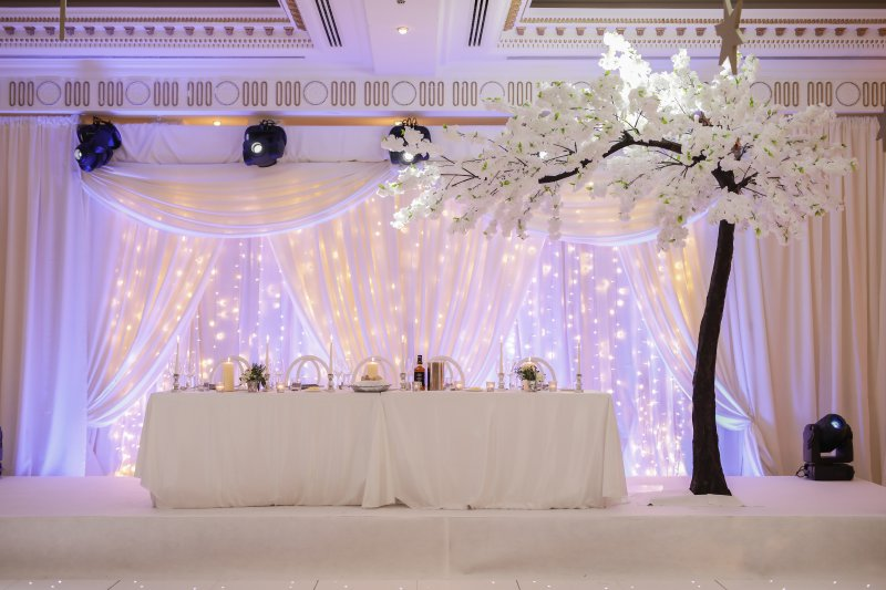 Draping and fairy light backdrop Powerscourt Hotel